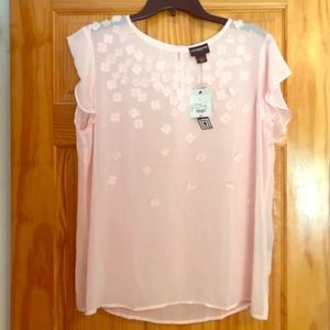 Pink sheer blouse with flower accents